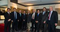 (LR) Aydan Karamanoglu (Turkish Embassy), Dr. Hasan Tuluy (World Bank), G. Lincoln McCurdy (TCA), Harun Tuncer (TIKA), Congressman Ruben Hinojosa (Chair of the Hispanic Caucus and Institute), Charles Patterson (SID), Can Oguz (Turkish Embassy), Baris Tantekin (Turkish Embassy), and Paul Moorehead (SID).