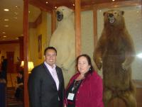 Mellor Willie, left, and Cheryl Causley, executive director and chair respectively of the National American Indian Housing Council, may have posed in front of bears during the group's recent annual meeting in Alaska, but the outlook for Native housing isn't totally bearish. (By Mark Fogarty)