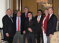 From left to right: Mayor Albert Huntington; Dr. Ahmet Gultekin, President-elect of the Tristate Turkish American Association in Cincinnati, Ohio; Dr. Justin McCarthy, Ottoman Scholar at the University of Louisville in Louisville, Kentucky; Alp Berker, Regional Vice President of ATAA in Indianapolis, Indiana; the Honorable Kenan Ipek, the Turkish Consul General in Chicago, Illinois; Dr. Sue DeWine, President of Hanover College; and G. Lincoln McCurdy, President of TCA. Participating in the ceremony but not pictured are Talha Uzun, President of the American Turkish Association in Indianapolis ; Daniele Berker and Uzay Kirbiyik of Indianapolis ; and Beth McCarthy of Louisville.