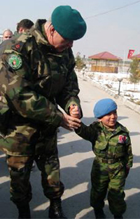 A little Afghan boy, Numan Rahman (right), is seen together with Brig. Gen. Levent Çolak (left), top Turkish commander in Afghanistan. Little Numan wearing Turkish military uniform is the mascot of the Atatürk military hospital in Kabul. Photo Credit: Hurriyet Daily News.